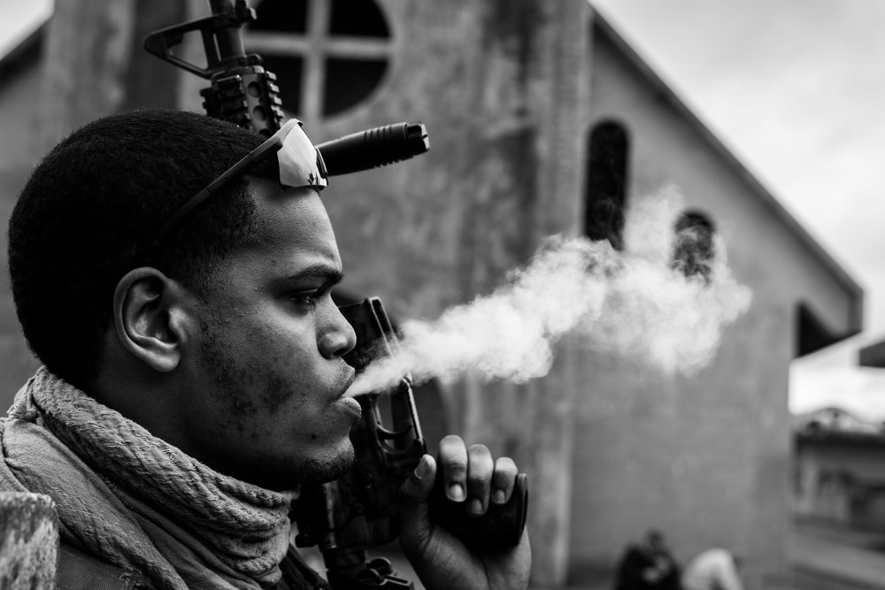 An airman stops for a quick smoke break between exercises at Camp Hansen. Senior Airman Jenkins, 18th Security Forces Squadron, Camp Hansen, Okinawa, Japan