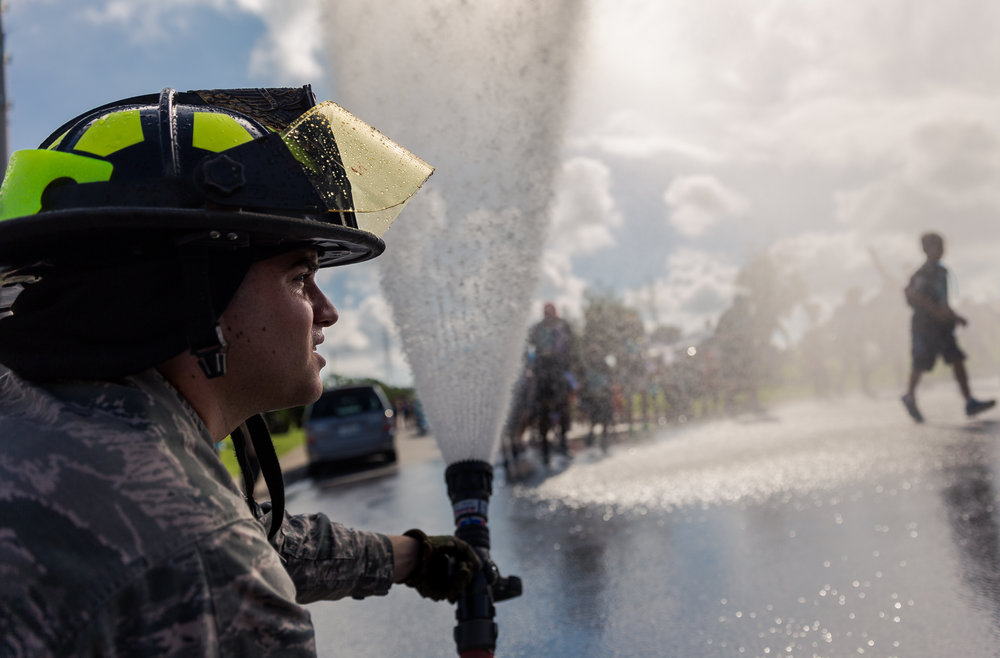 An Airman with the fire department on Kadena provides the water for the local USOs H2GO run. Airman First Class O'Shell, Kadena Fire and Emergency Services, Kadena AB, Okinawa, Japan