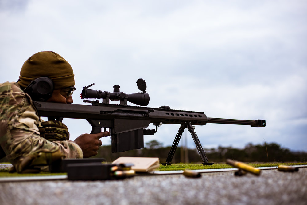 An airman lines up his sights to fire the Barret .50 Cal for qualification, 18th Civil Engineer Squadron Explosive Ordnance Disposal, Camp Hansen, Okinawa, Japan