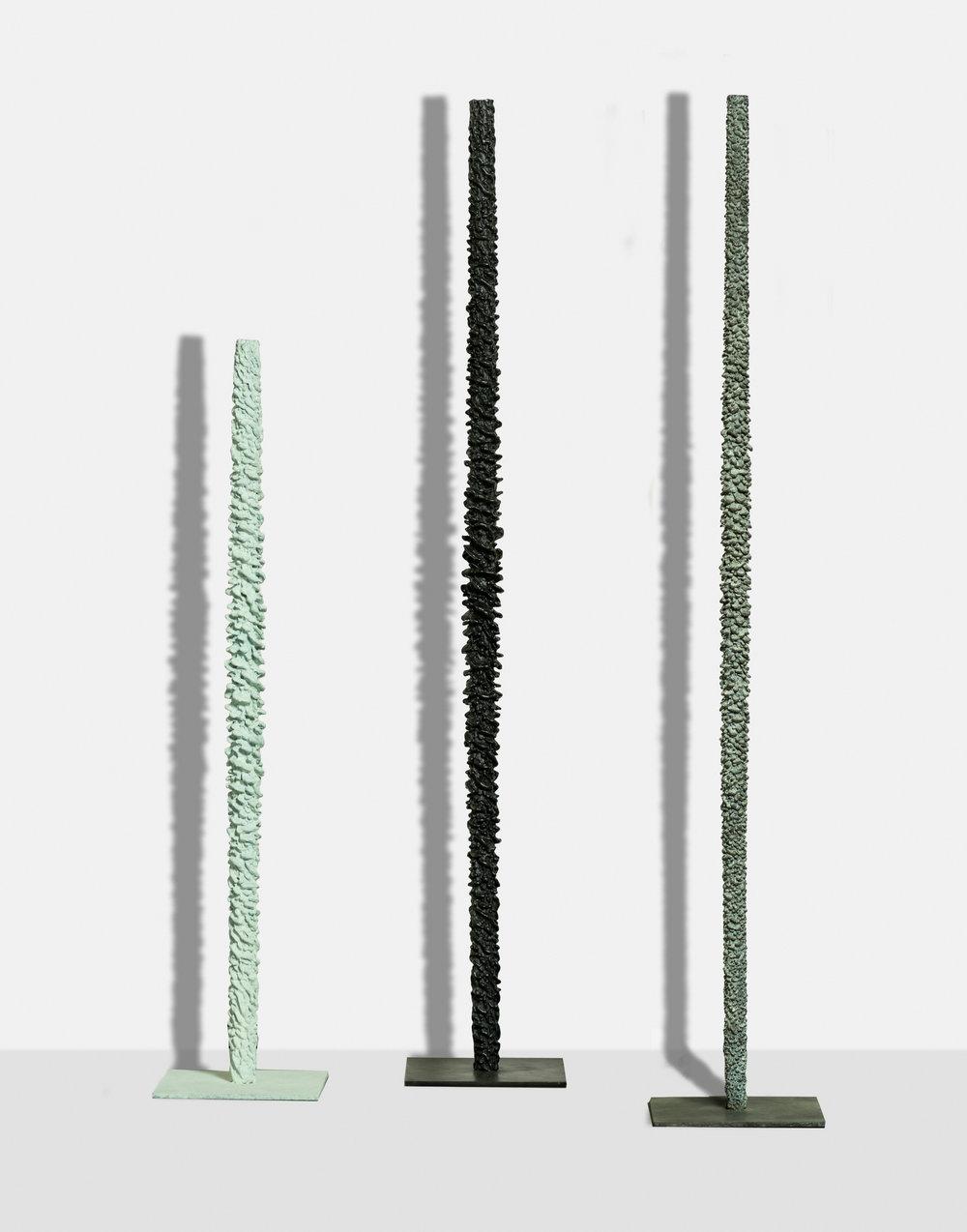 White Spiral , 2017, bronze (unique cast),  36 x 7 3/4 x 7 3/4 inches   Black Spiral (I),  2017, bronze (unique cast), 48 x 7 7/8 x 7 7/8 inches   White Totem (II),  2017, bronze (unique cast), 48 x 7 7/8 x 7 7/8 inches