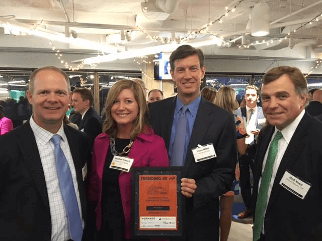 American Capital Deputy GC and honoree Heather French and her husband, Airside Mobile CEO Hans Miller, are flanked by Mayer Brown LLP partners Matt Rossi and Reginald Goeke.
