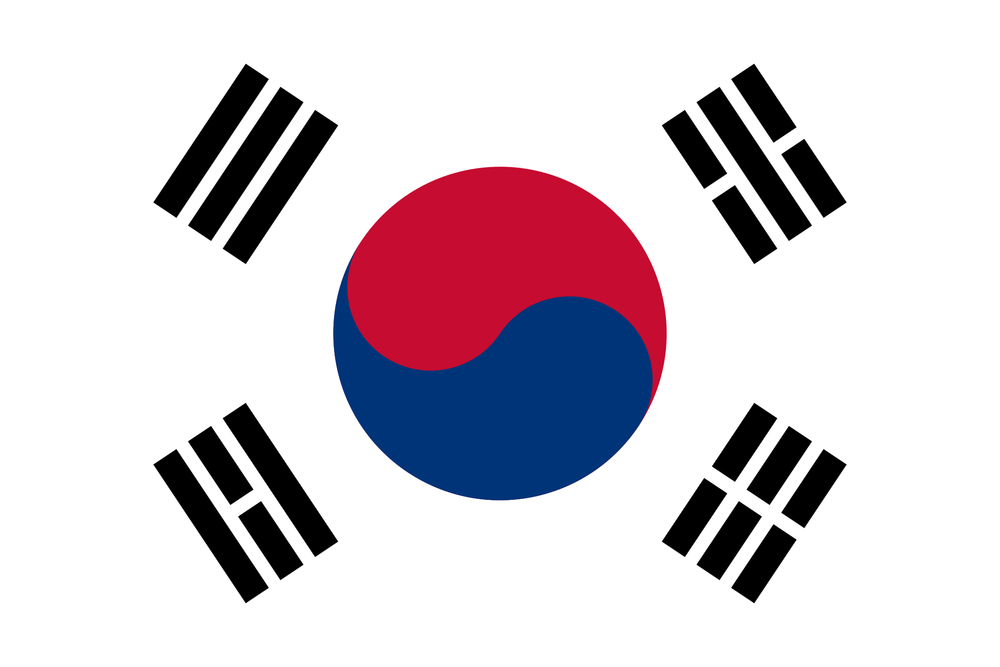 Also called Taekkuk (referring to the Yin and Yang halves of the circle in the center of the flag) the Korean flag exudes balance and harmony.   The red and blue circle in the center is called 'Taeguk', the origin of all things in the universe. The central thought is perfect harmony and balance: A continuous movement within the sphere of infinity, resulting in one unit. The blue part of 'Taeguk' is called 'Eum' or in Chinese, Yin, and represents all negative aspects of the balance while the red part is called 'Yang' and describes all the positive apects. The circle itself represents unity - bringing together the negative and the positive, while the Yin and Yang represent the duality. Examples of duality are heaven and hell, fire and water, life and death, good and evil, or night and day  The four trigrams at the corners (called 'Kwe' in Korean) also represent the concept of opposites and balance.