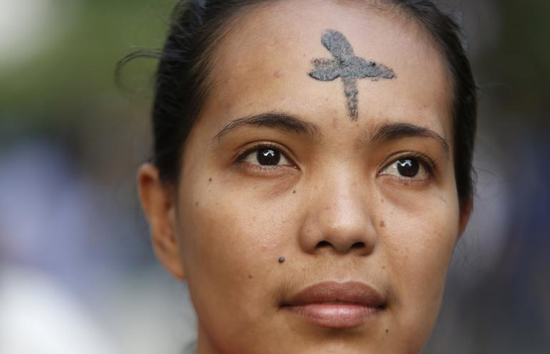"A Filipino woman has her forehead graced with ashes in remembrance of the Christian holiday ""Ash Wednesday,"" marking the culmination of the penitential 40-day season of Lent."