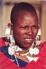 A Maasai woman with facial markings on her cheeks.