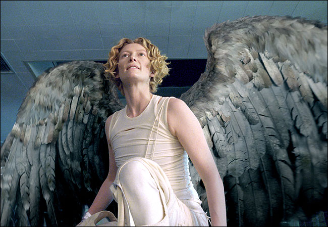 "Tilda Swinton as an androgynous angel in ""Constantine"" with co-star Keanu Reaves."