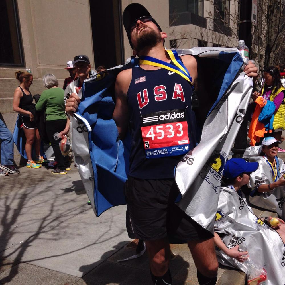 The author in holy rapture at the finish line of the 2014 Boston Marathon.