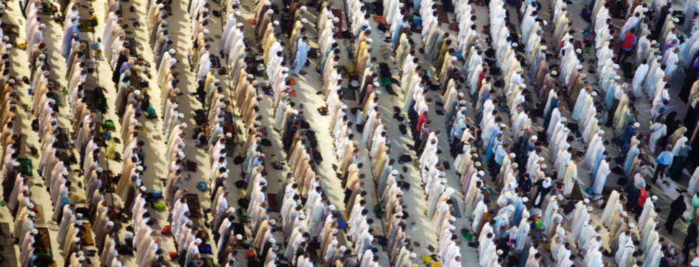 Muslims gather for prayer (PHOTO: The Conversation US).