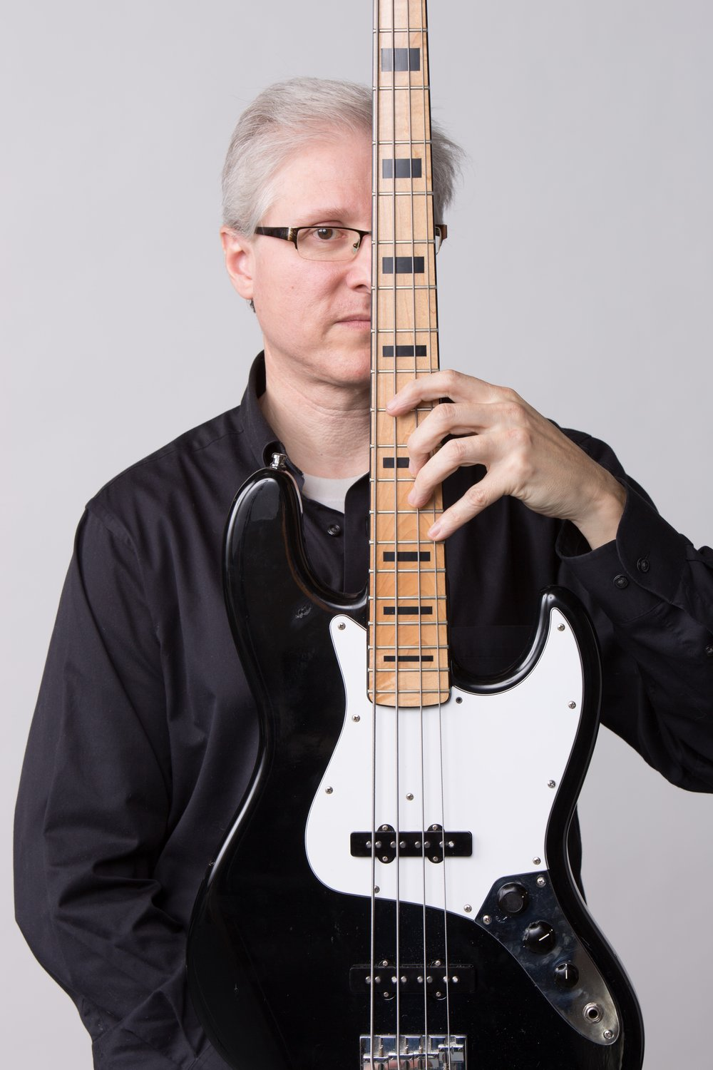 MIKEMike Bitts has been a member of NakedEye since 2014. Besides being a top-notch bassist, he's also an arranger with an ear for the NakedEye sound. -