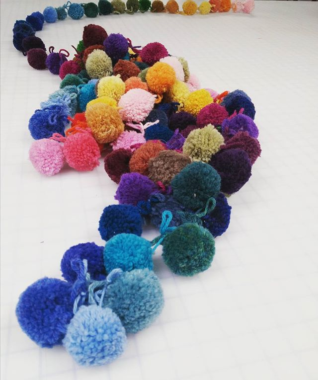 When you work at a fiber arts shop you inevitably come across the sleeping pom pom creature. 🐙 #fiberarts #pompoms #creatureofthedeep