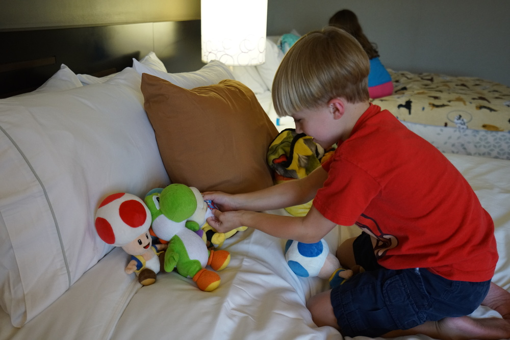 Miles staging his Mario toys out, getting ready of a day of gaming fun.
