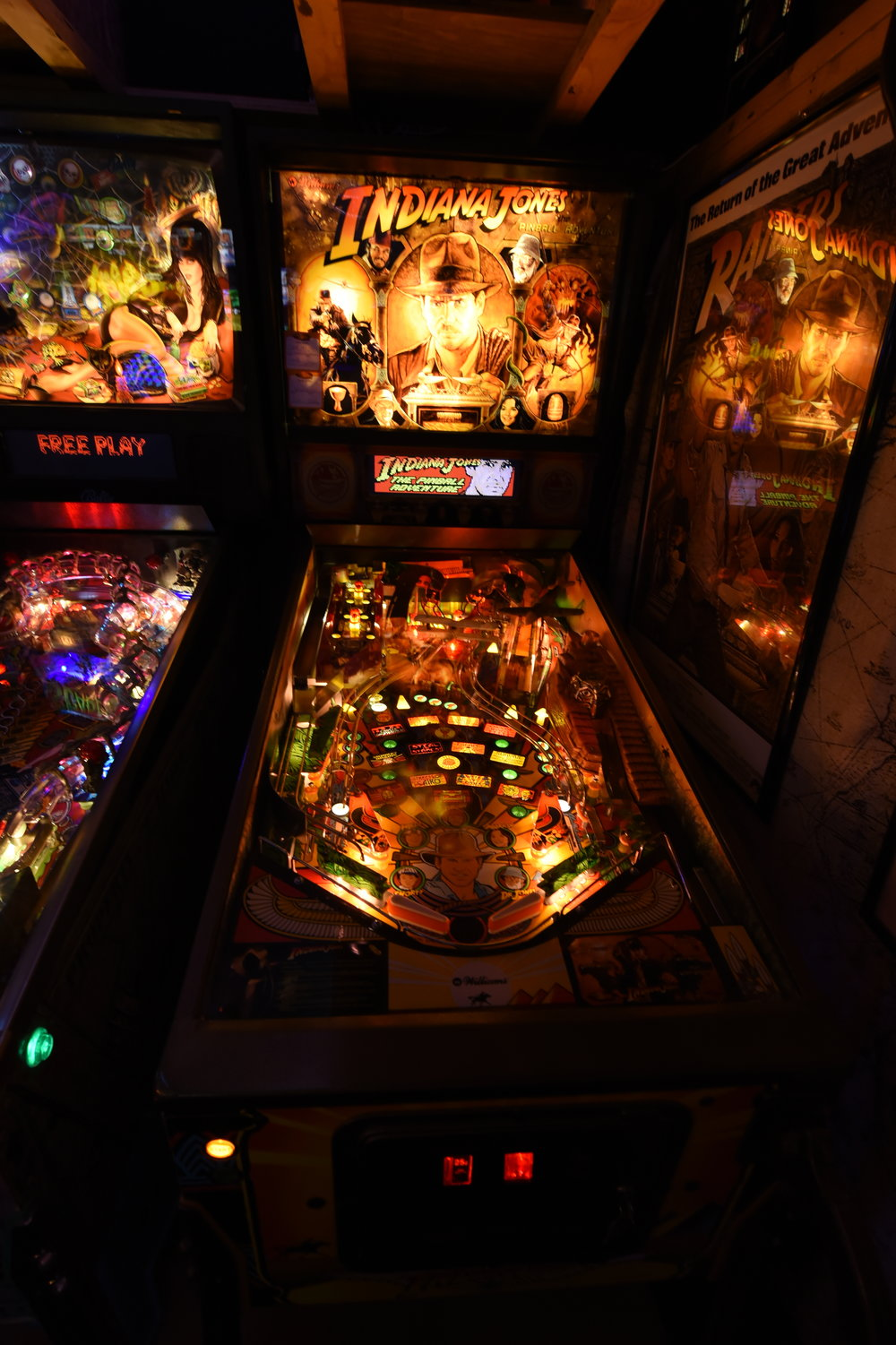 The longest lasting Pinball in my collection, Indy is still my favorite pinball. An upgraded player's quality game, it has custom golden-vein, relic-inspired powder-coated metals. It is running a customized Pinsound orchestration to bring John Williams iconic sound to the gameplay experience but still nods to the original mix quite well. The playfield is pretty good and the plastics look great. It has OCD LED on the controlled lamps and I recently went back to incandescents in the GI, trying to add the warm-fire-glow back to the game. The side art has alot of fade and a few gashes. Instead of cabinet decal, I'd like to find a mural artist to brighten the colors back but keep the original elements in-tact.