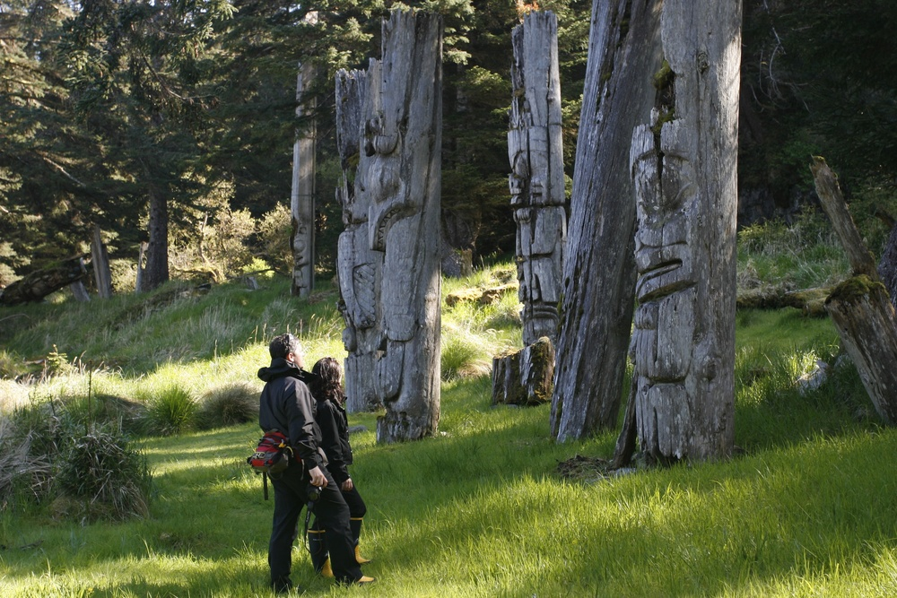 Haida totem poles. Photo by Kevin J. Smith/Maple Leaf Adventures
