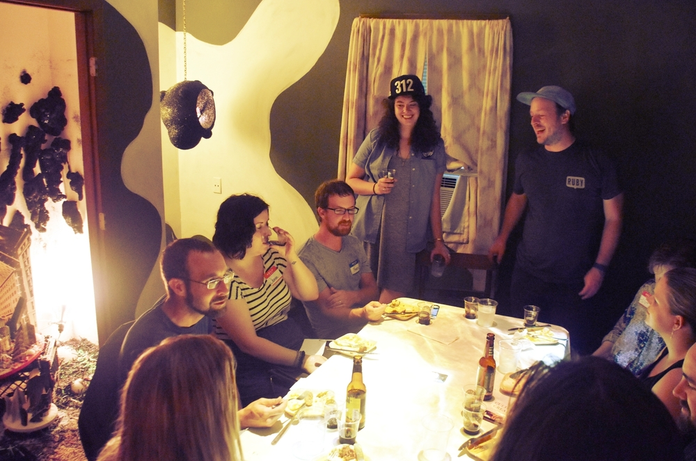 Cara Condon from Goose Island (standing, left) and Jonny Hunter of Underground Food Collective (standing, right)  lead guests to consider the importance of sourcing local ingredients while tasting Goose's rare Bourbon County Coffee Stout.
