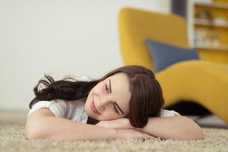 woman lying on carpet