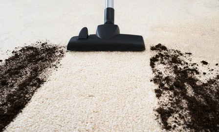 vacuuming dirt off of a carpet