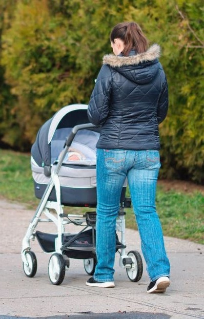 woman with baby stroller