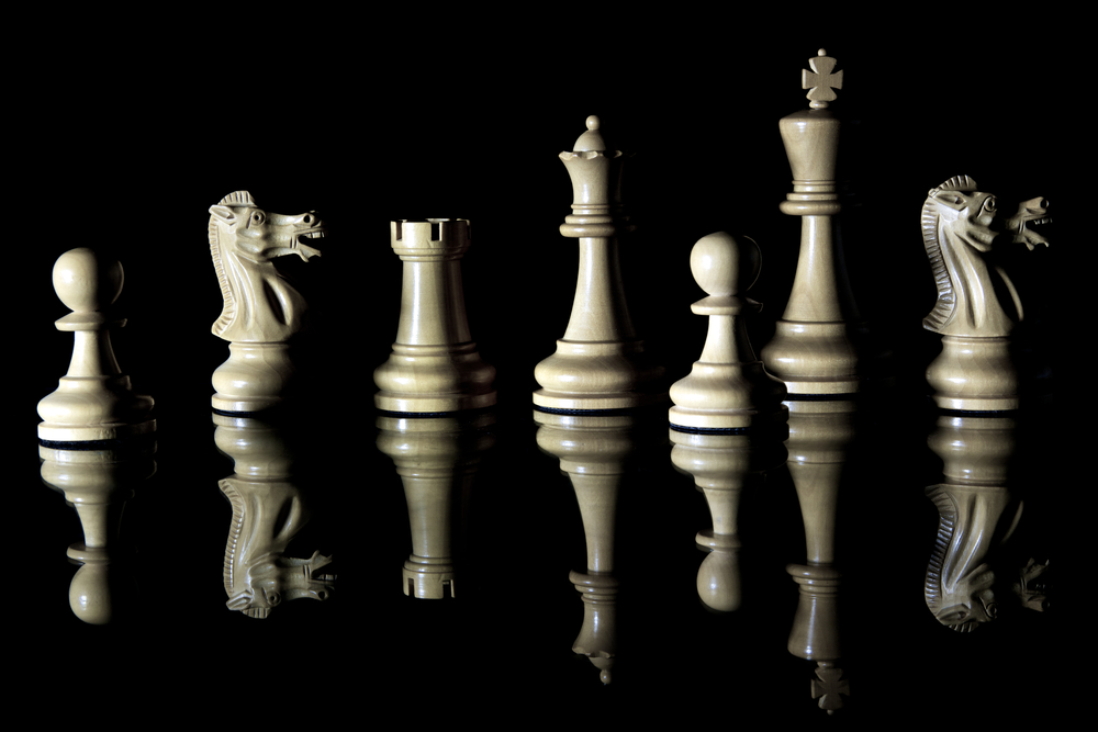 """ Reflected Chess pieces "" by  Adrian Askew  is licensed under  CC BY 2.0 ."