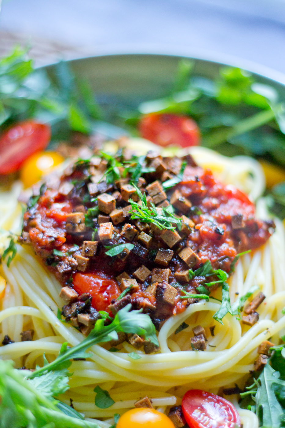 Fakon topping on gluten free corn spaghetti with tomato sauce.