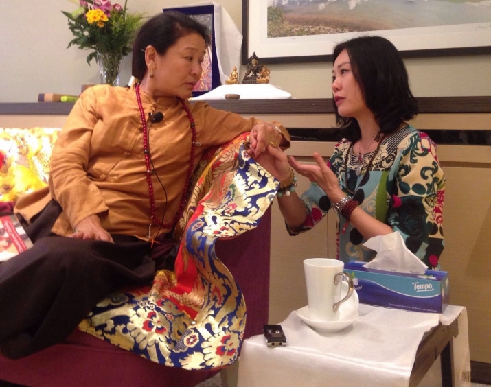 Rinpoche shares a tender moment with her disciple, Jan. From Jane Miknius