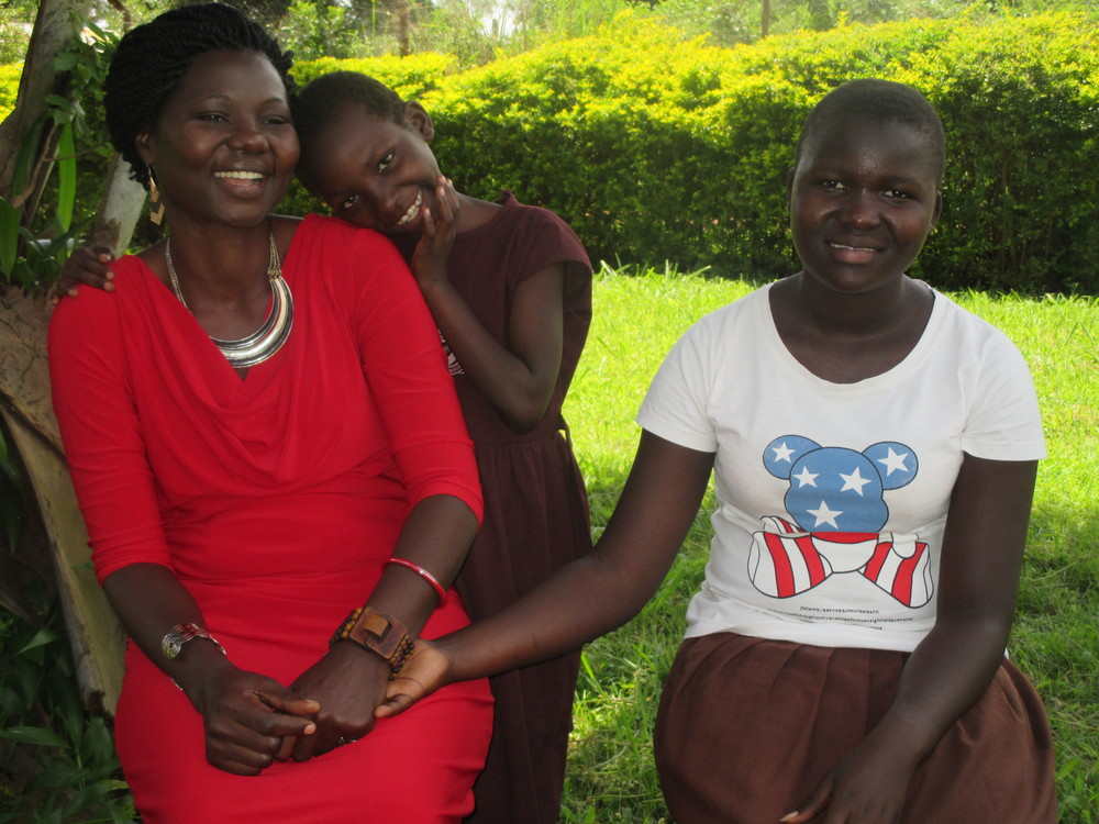 Dedicated people like Jane Ekayu (left), who founded Children of Peace Uganda, make a tremendous difference in the lives of these young people.