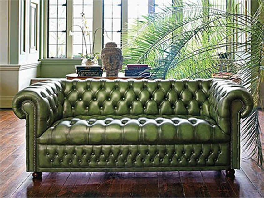 Green leather Chesterfield couch already installed in the living room