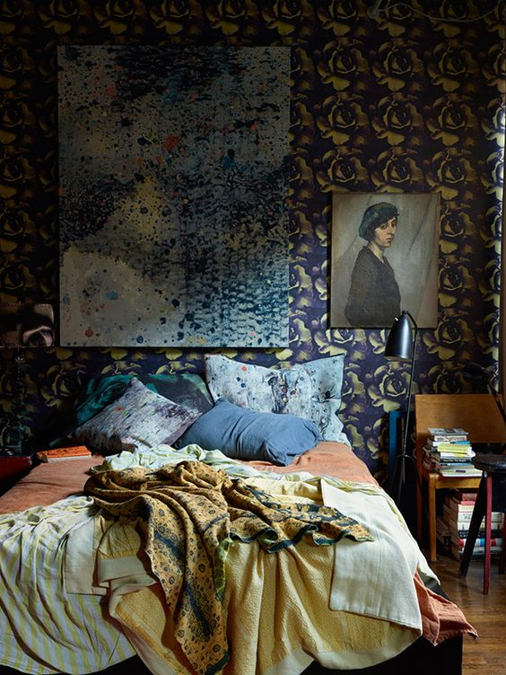 A bedroom in Martyn Thompson's loft, featuring his own wallpaper and pillowcases made from his fabric designs. Photo originally from a 2015   New York Magazine   shoot.