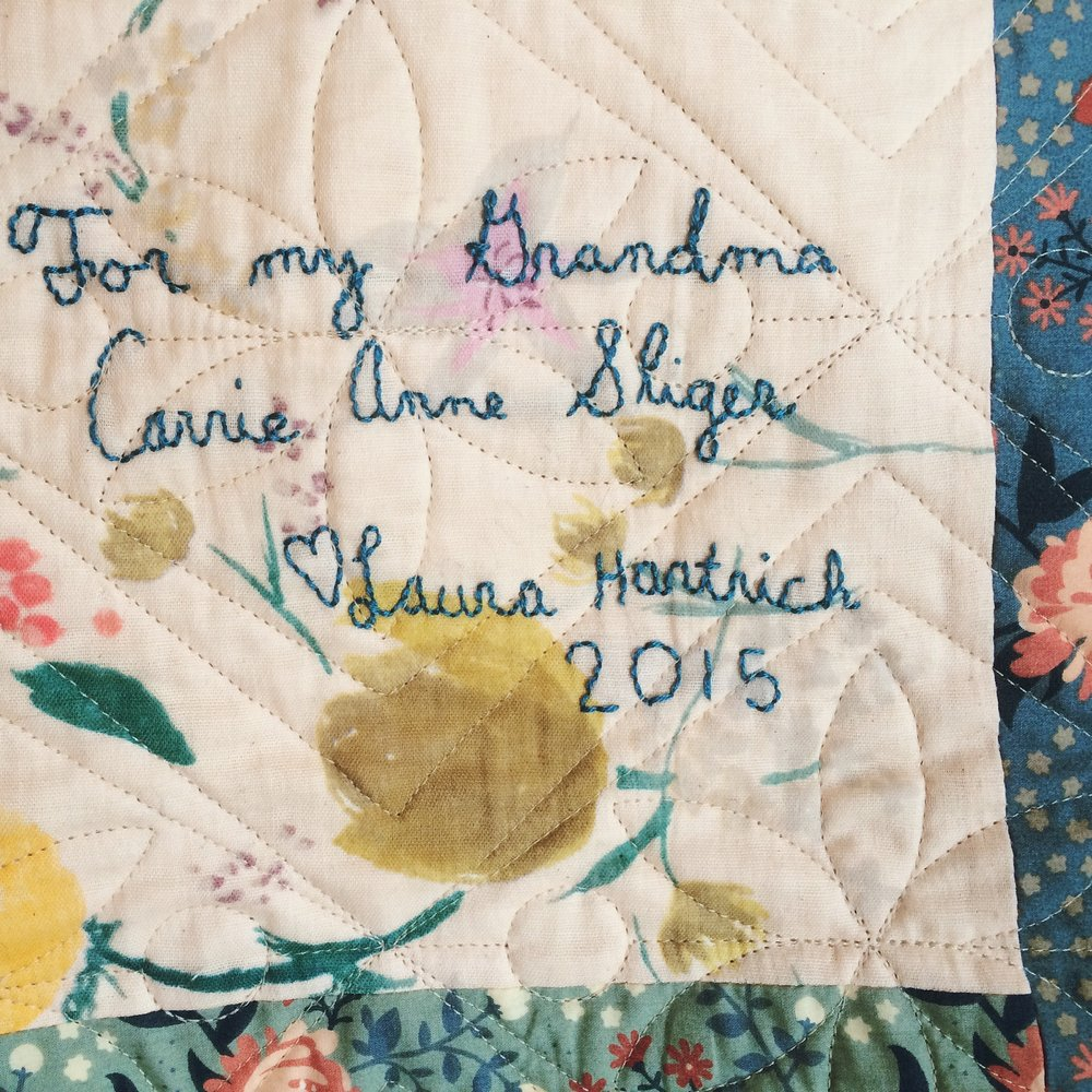 hand-stitched label on back of quilt