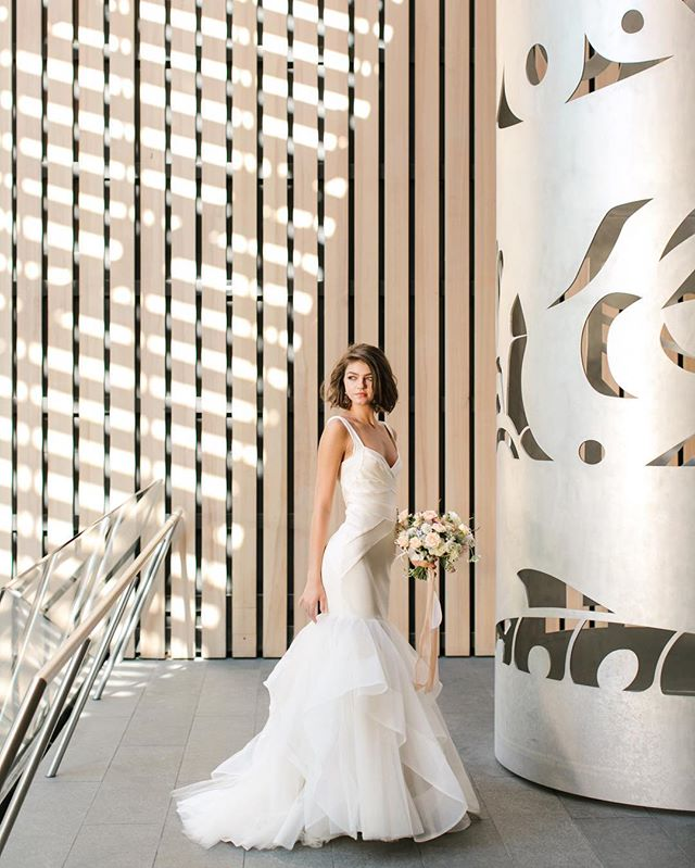 One of my favourite images from a recent editorial we shot in Whistler at the stunning @audainartmuseum. Featured in the current issue of @wedluxe magazine… I'm sharing more images in my stories today, please check it out! So many talented people involved in this one:  Concept: @celebratewhistler  Floral and decor design: @celebrateevents_decor  Stylist: @flock.event.design  Stationary: @hellomaurelle  Gowns: @pronovias @alonlivnewhite @misshayleypaige from @blush_bridal  Hair and makeup @beebeebrenda  Jewelry: @keirjewellery  Catering: @toquecatering  Cake Design: @the_flour_pot