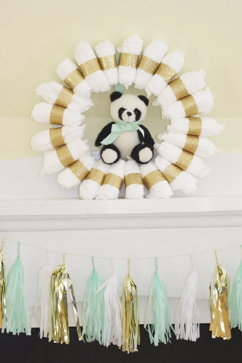 I made the wreath from diapers and glittery ribbon.