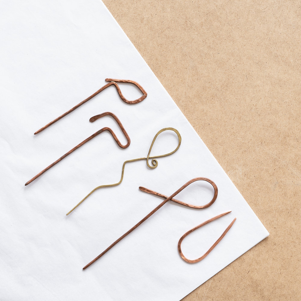 Hair Pin Class - $45 (brass/copper) $65 (silver)Bend and forge wire into a functional hair or scarf pin. Similar in design, these multi-functional pins can be used to secure your hair or a thick-knit scarf.