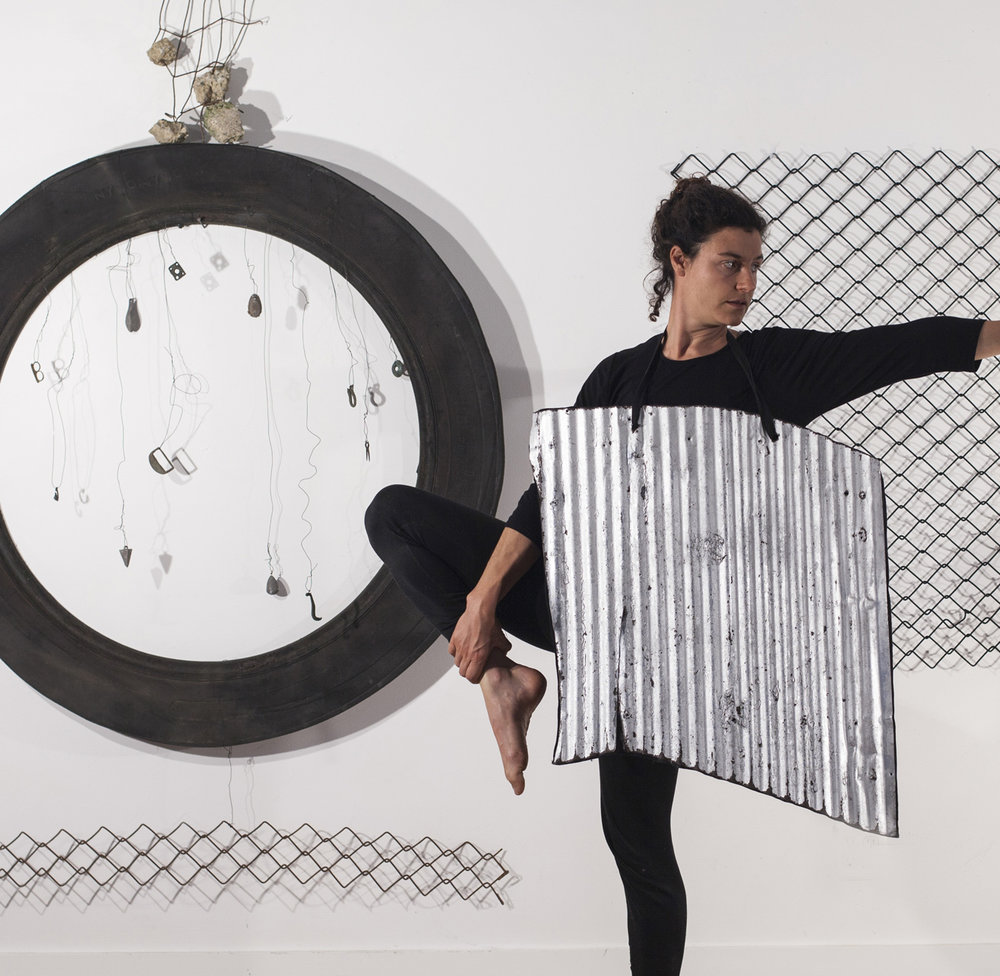 #1040 (Sculpture and Dance Performance): Tire fragment, corrugated metal roofing, chain link fencing, fragment of wire reinforced concrete, small metal objects, daughter. The installation is 8' tall, 10' wide and 3' deep.