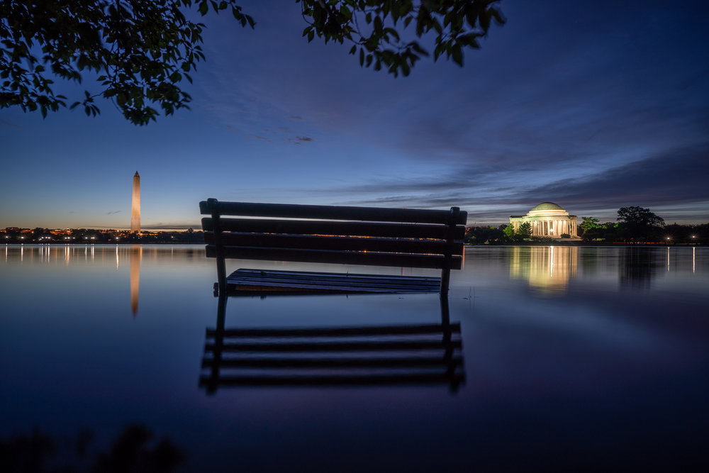 Nuisance Flooding by Kevin Wolf, Dawn bench/monument reflection image at flooded Tidal Basin
