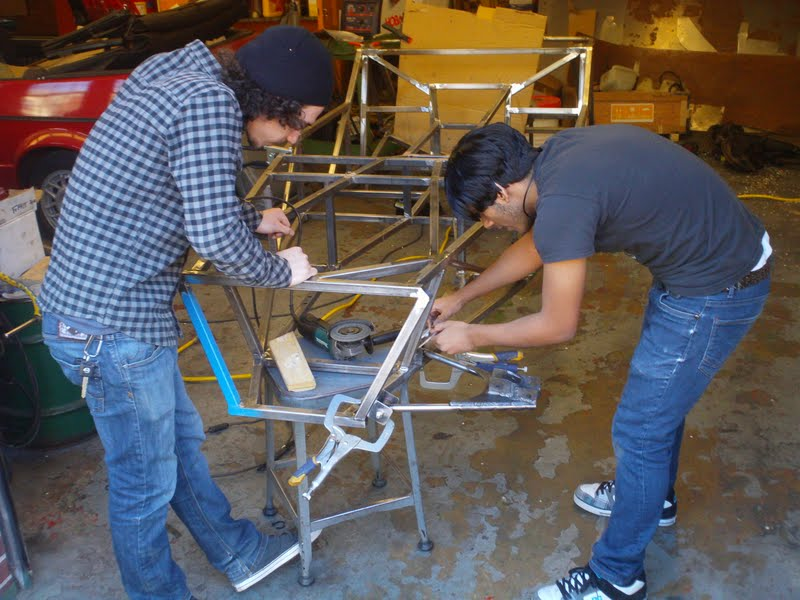 Damian and Adrian are installing the welded A-Arm.  Adrian designed the arm and I TIG welded it.  Great collaboration.