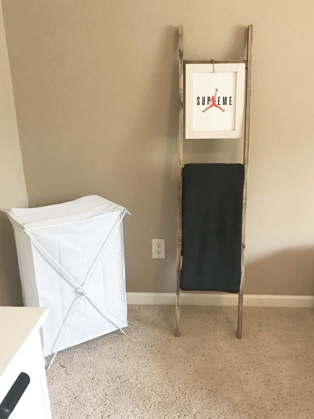 The clothes hamper is from Ikea. I made the ladder shelf.