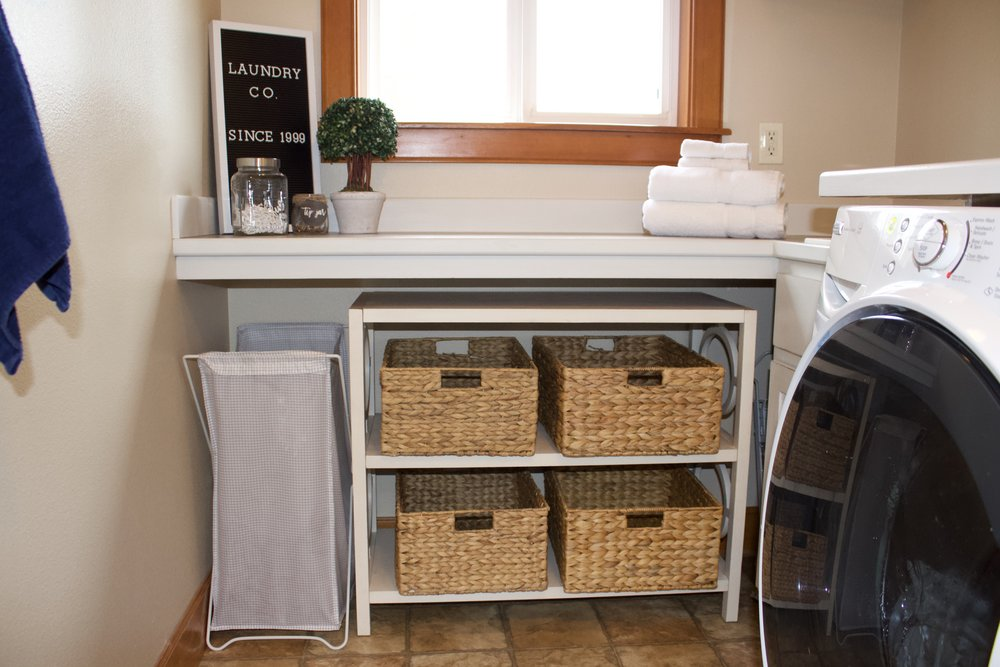 A simple bookcase with baskets hold clean, folded clothing.
