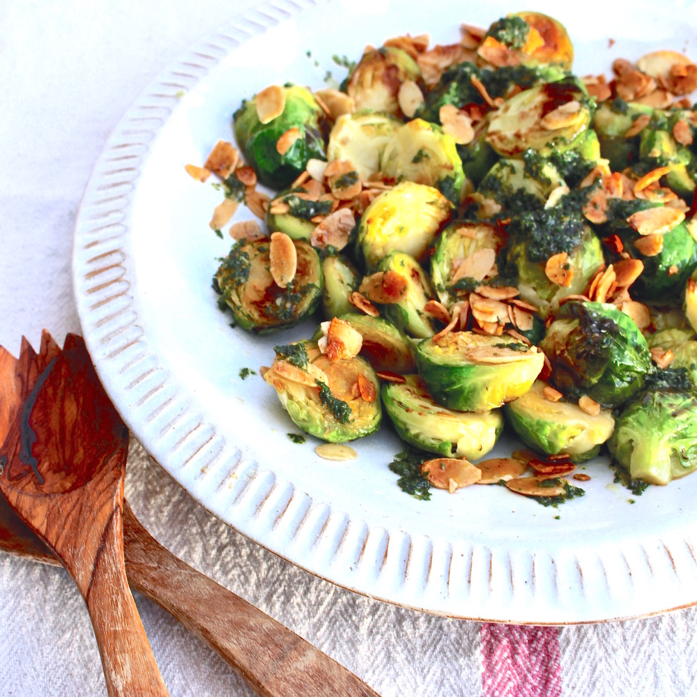 Pan-fried sprouts with thyme and honey dressing & salted almonds
