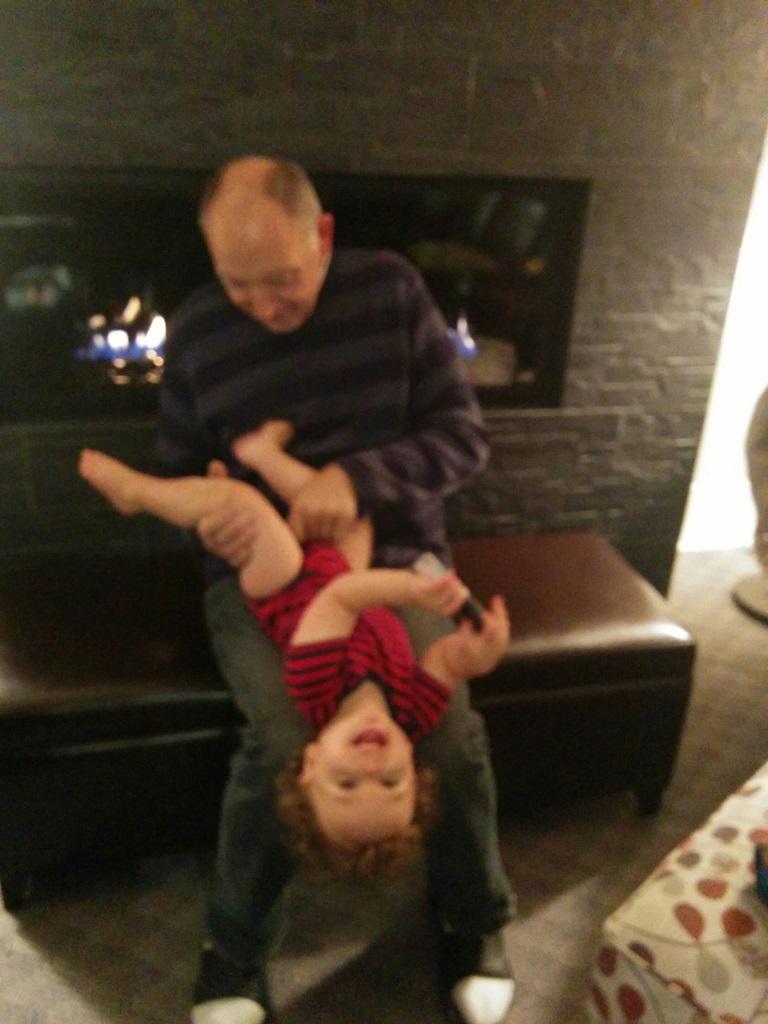 10. Grandpa dressing Isaac.jpg