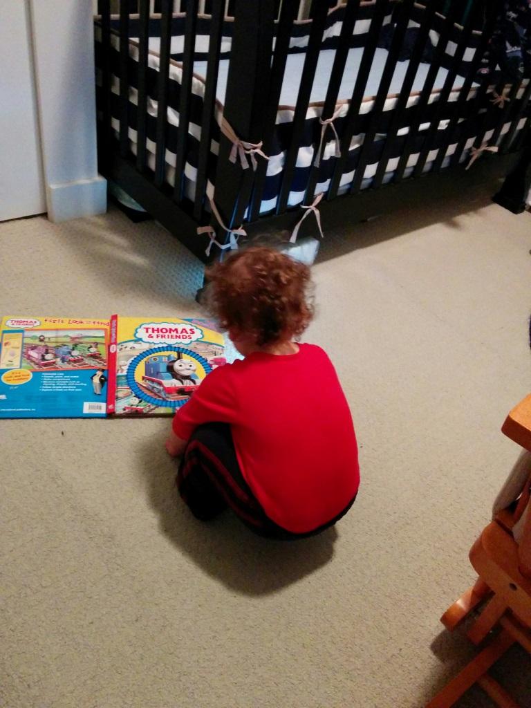 Reading in his room.jpg