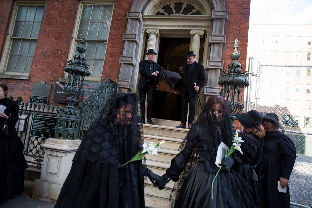 Roberta Belulovich (left) and I (right) as we begin the procession from the Merchant's House Museum. (Michael Nagle for Observer)