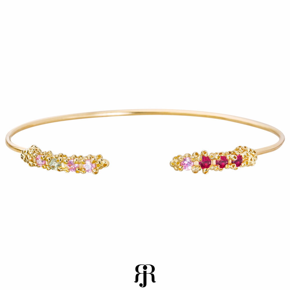 14K yellow gold, pink and green sapphires, rubies. Delicate and delightful arm candy cuff!