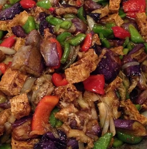 Sautéed tofu with eggplant, peppers & onion.