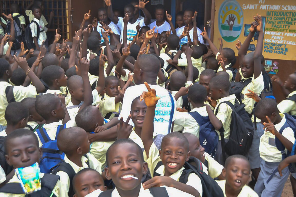 Happy school kids at opening of St. Anthony's Computer Lab