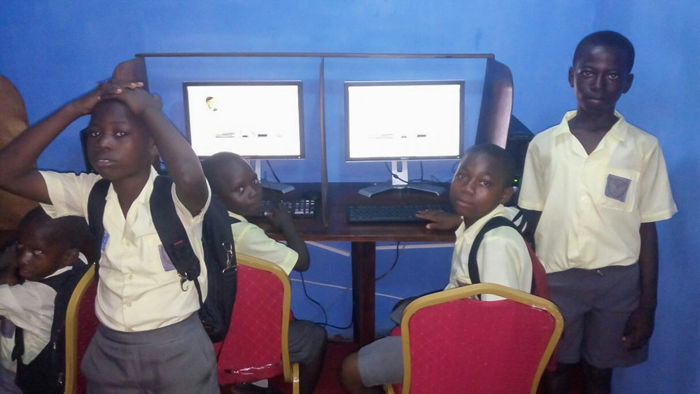 School kids working on computers for the first time