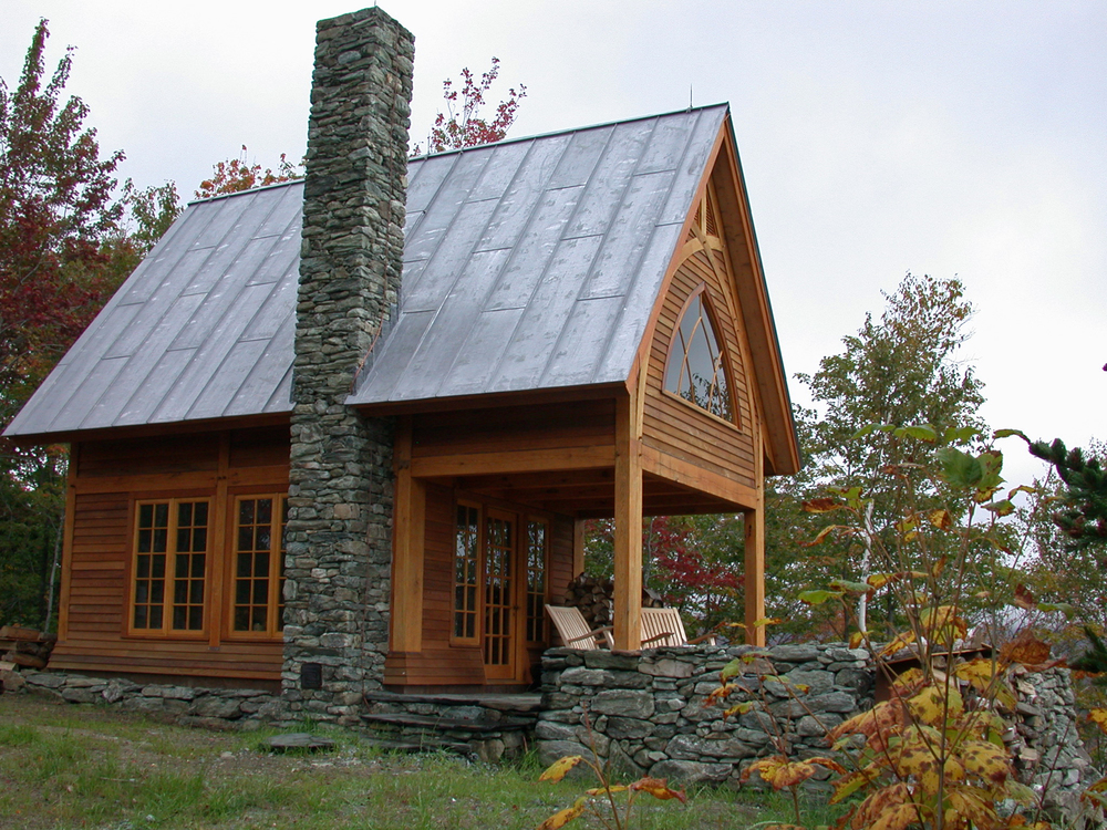 The timber frame was custom fabricated from red oak.  In addition to the retreat structure, there is also a combination out house and wood shed with a solar powered composting toilet.