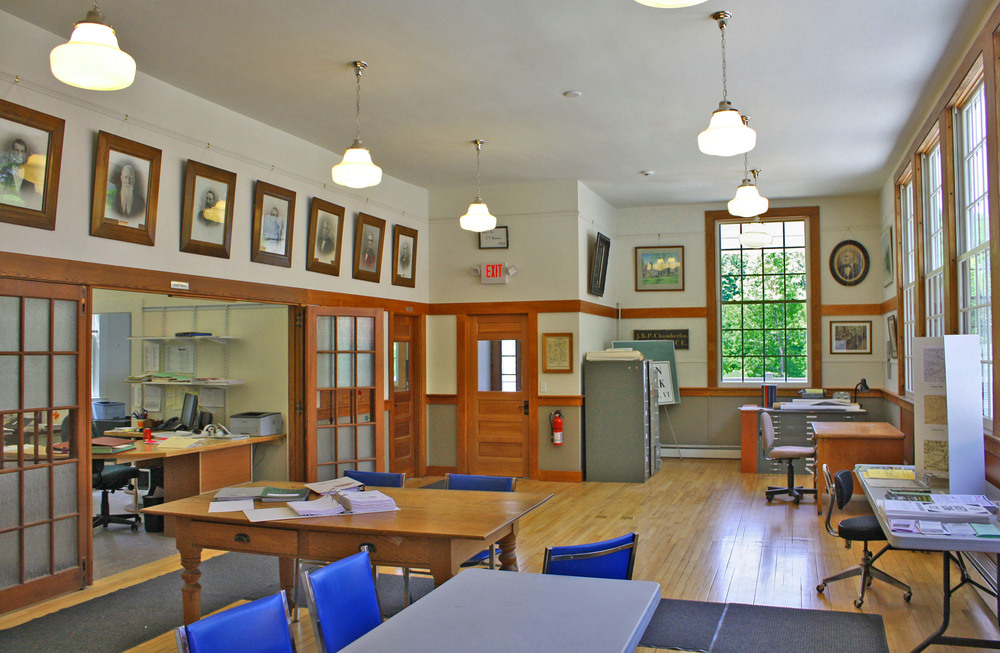 UK Architects renovated the interior of the building to provide separate offices for the town clerk, treasurer, and listers.  An addition to the back of the building provided a new, accessible entrance, an accessible restroom, and a fireproof vault for storage of town records.  New, energy efficient windows replaced old, drafty windows, and insulation was added to the attic and 60% of the exterior walls.