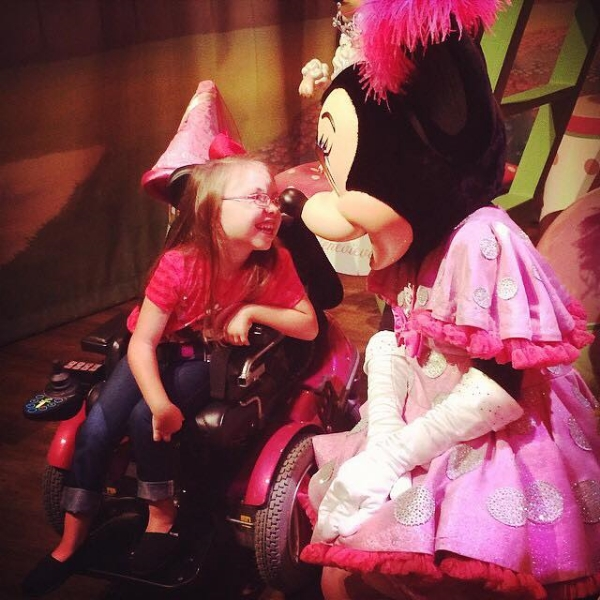 Ella meeting Minnie Mouse.