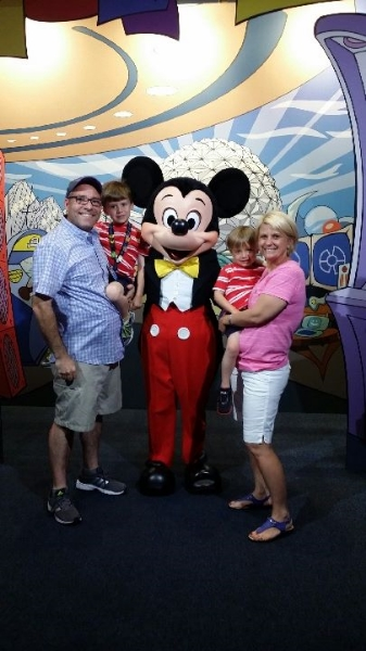 The kids, with their parents Gareth and Tara, hanging out with Mickey Mouse.