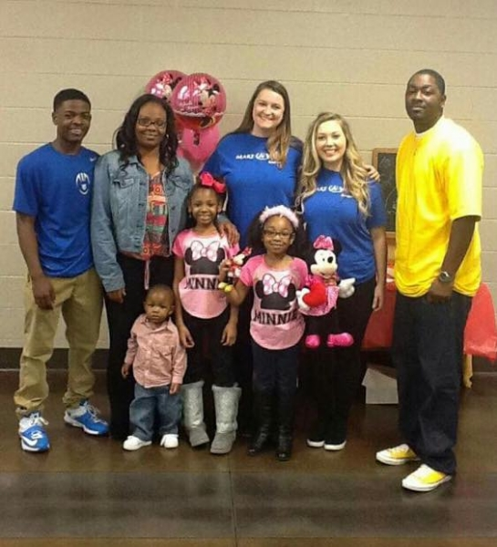 Jasmine and her whole family at her Make-A-Wish party.