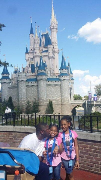 With her family in the Magic Kingdom.