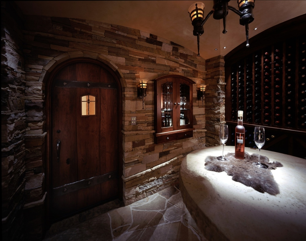 Wine cellar lighting gallerylight notes dessert wine cabinet flanked by two hand crafted fiber optic sconces simulating old world lighting arubaitofo Choice Image